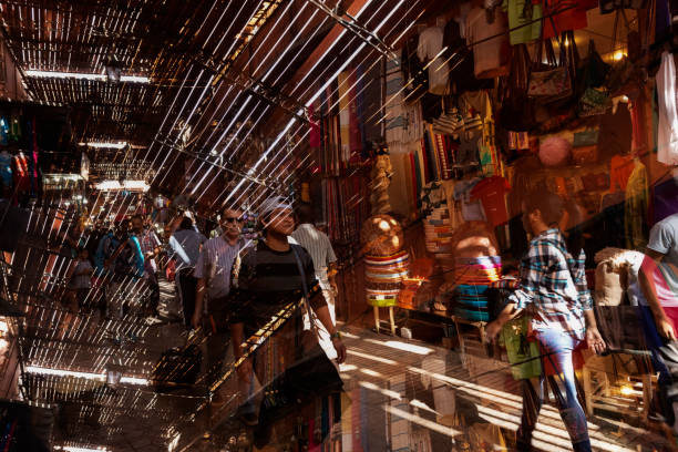 Busy street scene inside the medina, old town, with people shopping, November 6, 2017, Marrakech, Morocco. stock photo