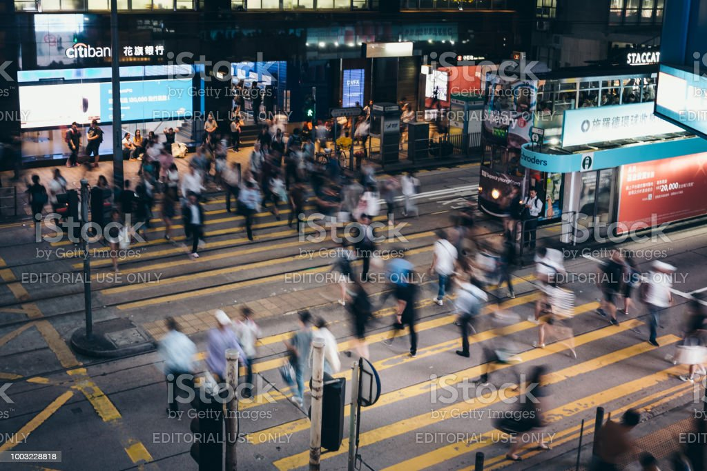 Busy streets of Des Voeux Road Central District Hong Kong. Streets...