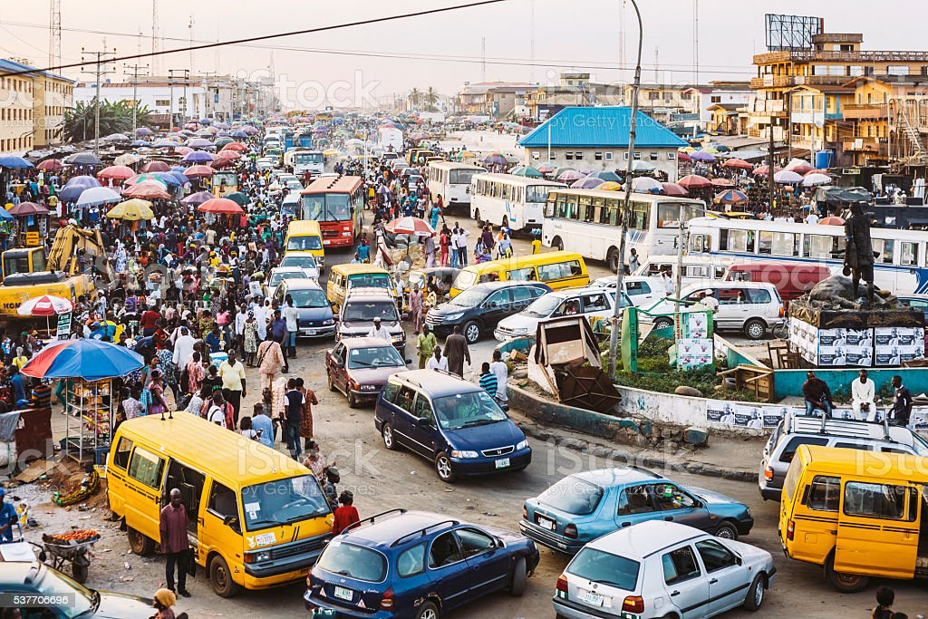 Busy streets of African town. Lagos, Nigeria. stock photo