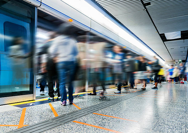 Busy subway station Busy subway station with large group of people. subway platform stock pictures, royalty-free photos & images