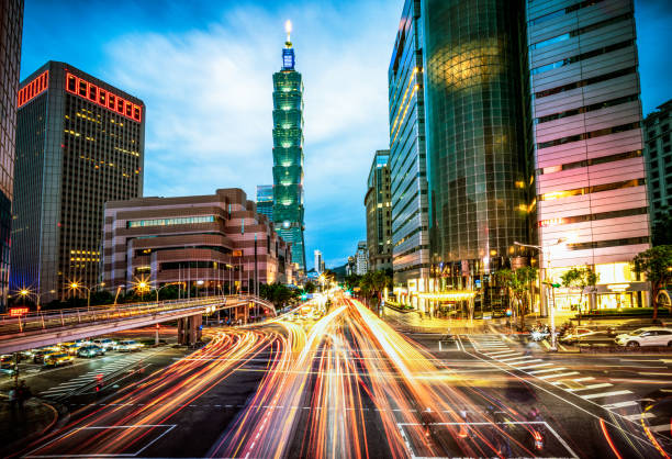 Busy Taipei streets at dusk Motion blur on busy streets during rush hour at dusk in Taipei's city centre. taiwan stock pictures, royalty-free photos & images