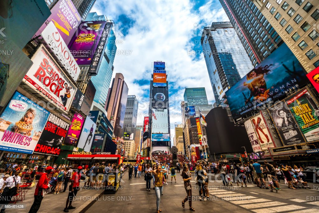 Busy Times Square in NYC. The place is famous as world's busiest place for pedestrians and an iconic landmark for thousands of tourists in Manhattan. stock photo