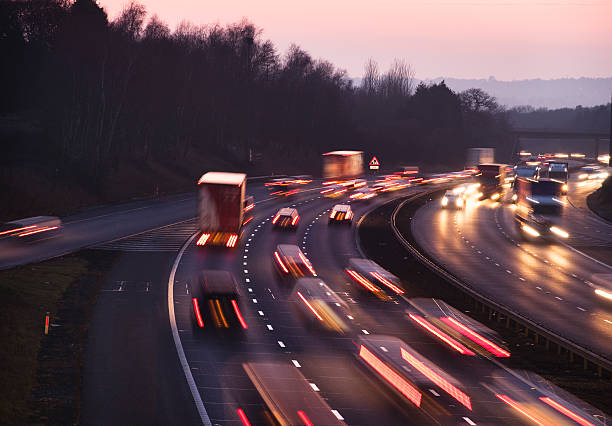 Busy traffic at dusk on the M42 Motorway near Birmingham Busy traffic looking west at dusk on the M42 Motorway. Shot from Junction 3, the A435 junction, just south of Birmingham.  multiple lane highway stock pictures, royalty-free photos & images