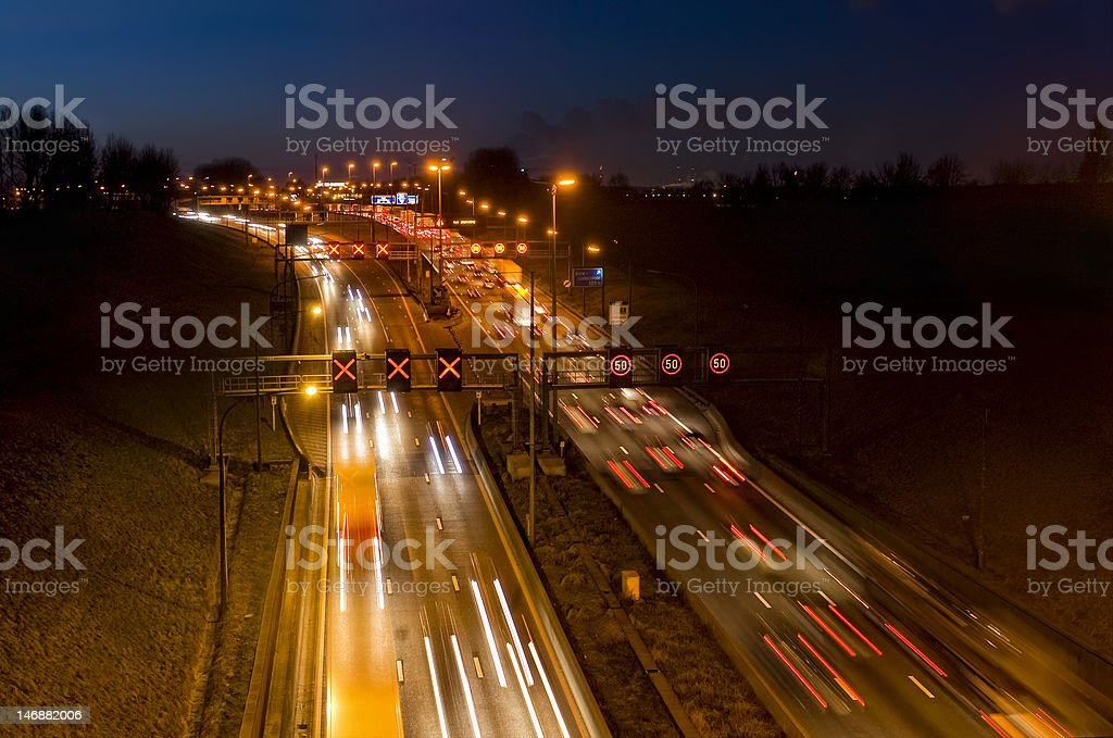 Busy traffic at night       (© Lobke Peers) royalty-free stock photo