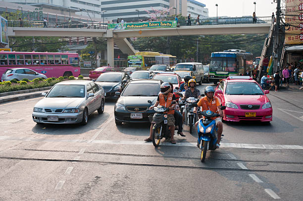 busy traffic in bangkok - motorbike, umbrella stock pictures, royalty-free photos & images