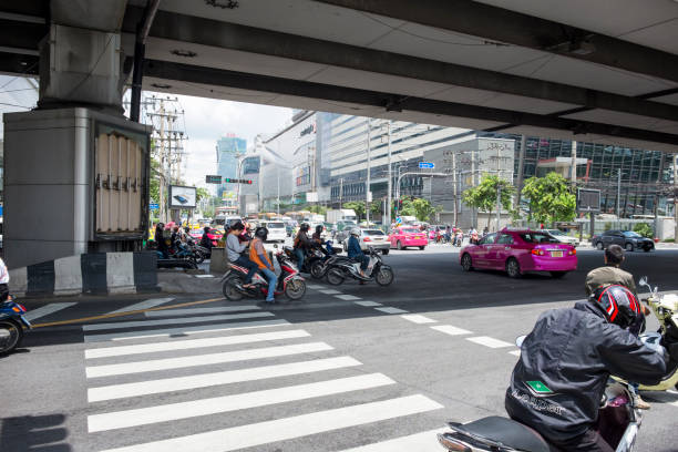 busy traffic in bangkok, thailand - motorbike, umbrella stock photos and pictures