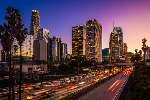 Busy traffic in Downtown Los Angeles at dusk.