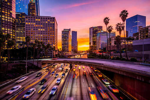 Busy traffic in Downtown Los Angeles at sunset.