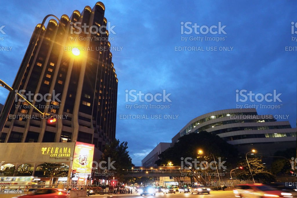 Busy Traffic in front of Furama City Center at night time in Singapore. stock photo