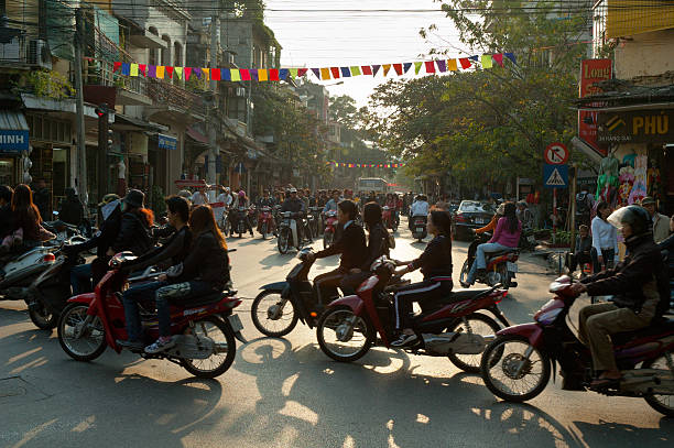 busy traffic in hanoi - motorbike, umbrella stock pictures, royalty-free photos & images