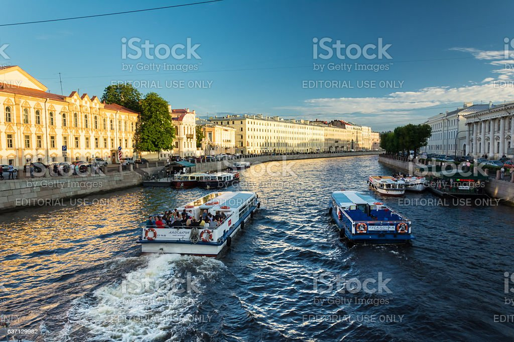 Busy traffic of boats on the Fontanka River, St. Petersburg stock photo