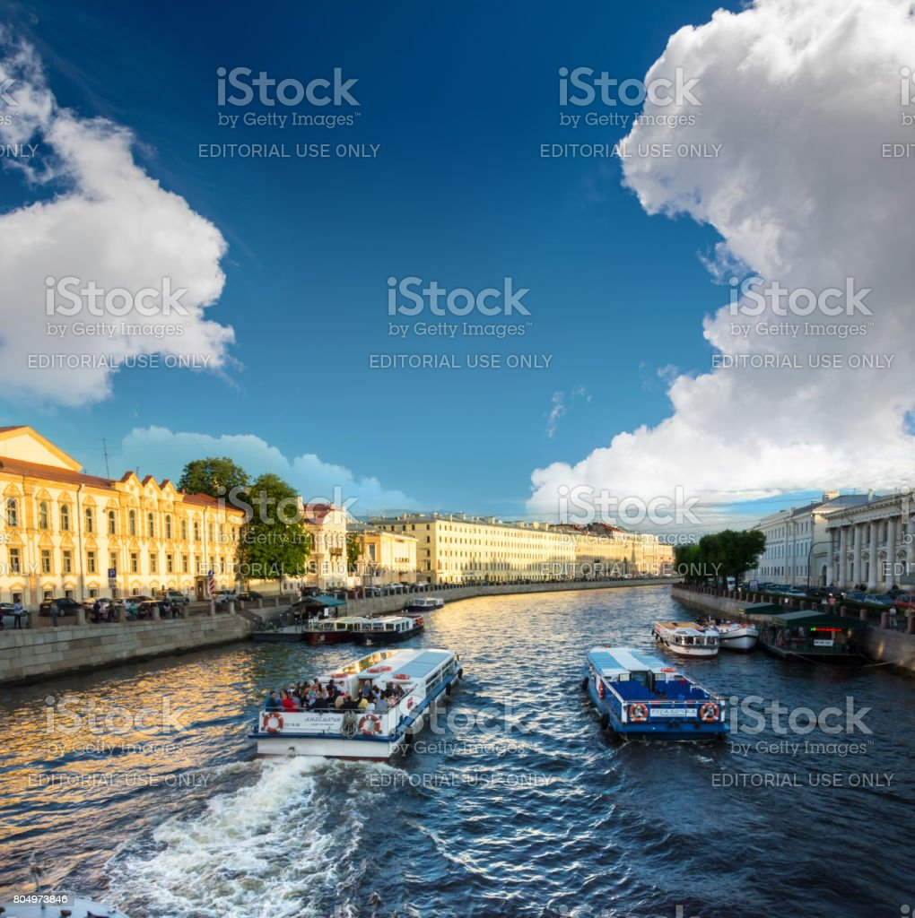 Busy traffic of boats on the Fontanka River, St. Petersburg, Russia. stock photo
