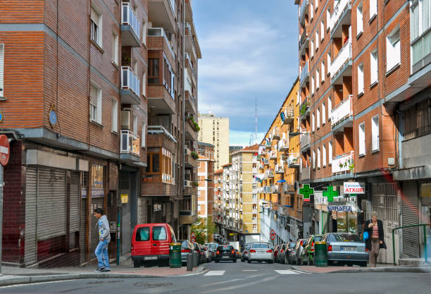 Busy traffic of people and car on the streets bright Bilbao city, Basque country in Spain stock photo