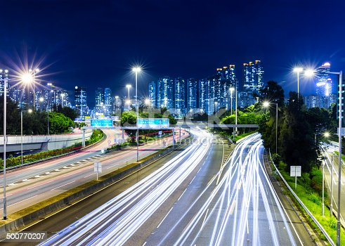 860696690 istock photo Busy traffic on highway at night 500770207