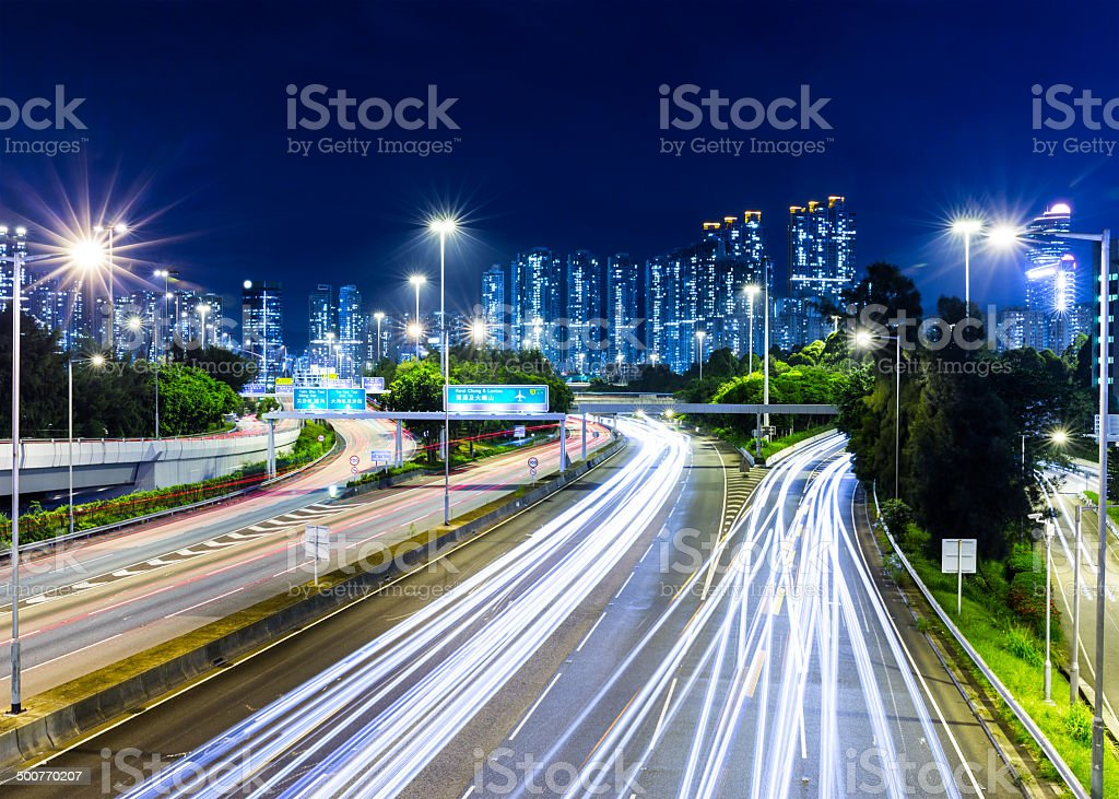 Busy traffic on highway at night stock photo