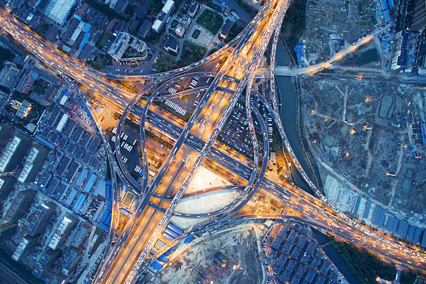 busy traffic on road junction at night in hangzhou aerial view of traffic on road junction at night in hangzhou overpass road stock pictures, royalty-free photos & images