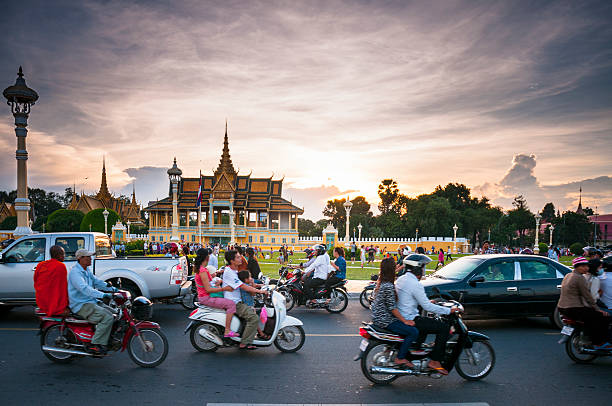 Busy Traffic Outside The Royal Palace In Phnom Penh stock photo