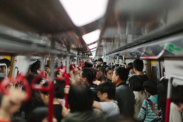 Busy Train A busy train in Hong Kong. underground stock pictures, royalty-free photos & images