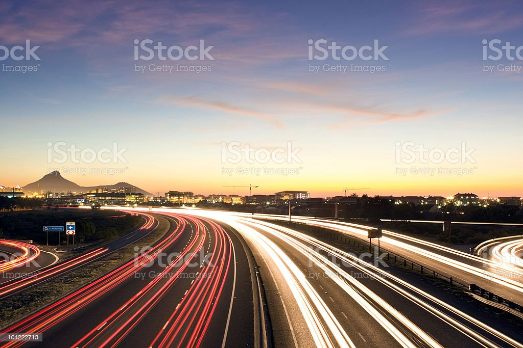 Busy urban highway at dusk royalty-free stock photo