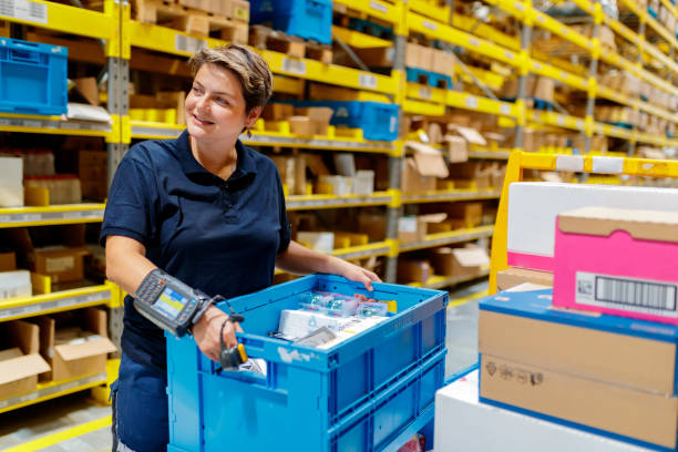 Busy warehouse worker stock photo