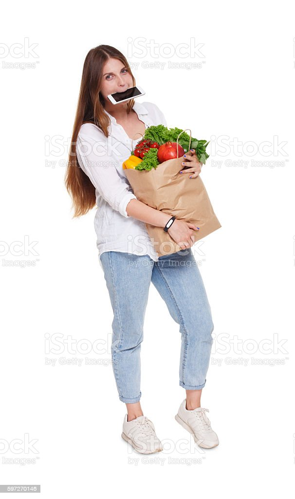 Busy woman hold bag with healthy food, grocery buyer isolated photo libre de droits