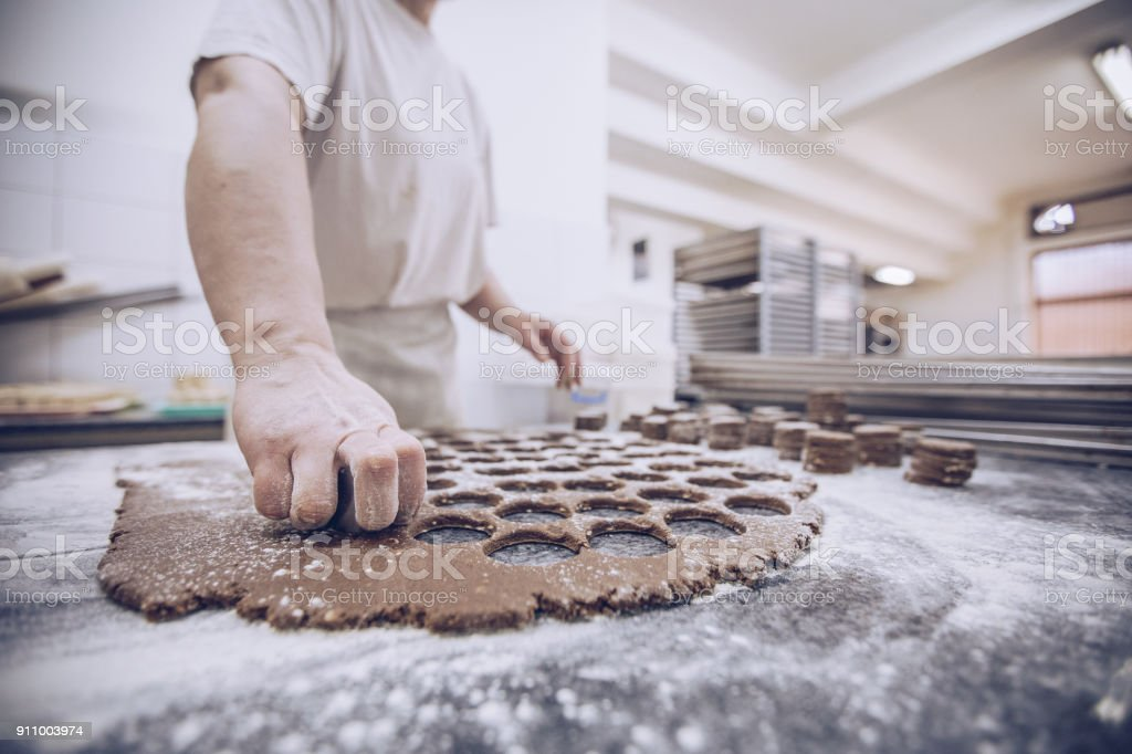 Busy woman in bakery stock photo