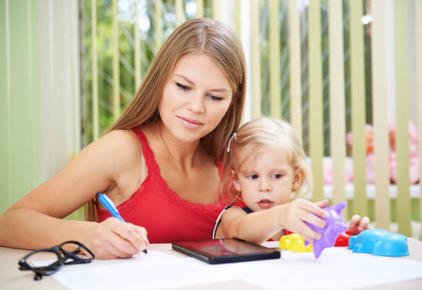 Busy woman working with child – Foto