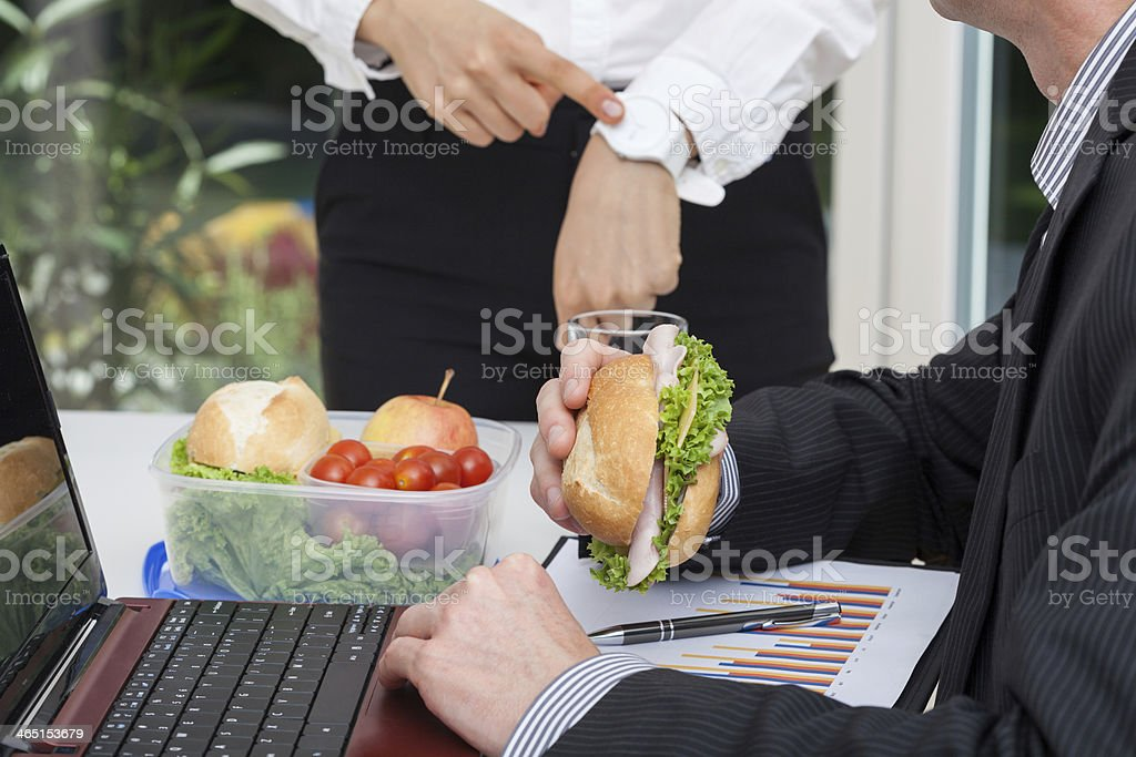Busy worker with his angry boss stock photo