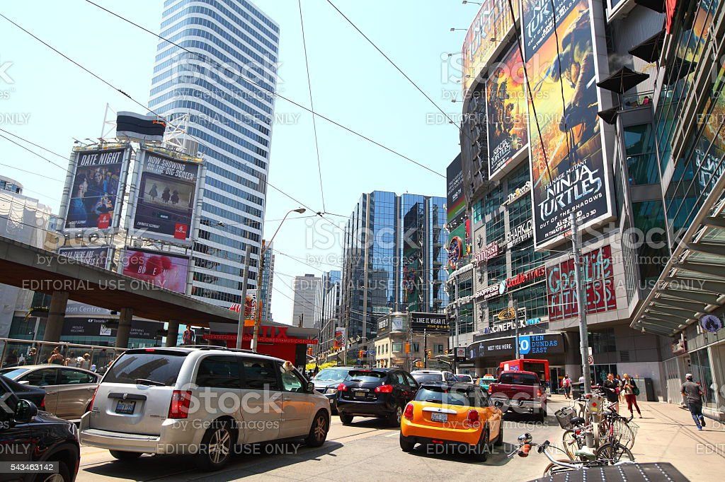 Busy Yonge and Dundas intersection with heavy traffic Toronto, Ontario, Canada - May 24, 2016: Busy Yonge and Dundas intersection (Dundas Square) with heavy traffic in downtown Toronto on a sunny day in May 2016 2016 Stock Photo