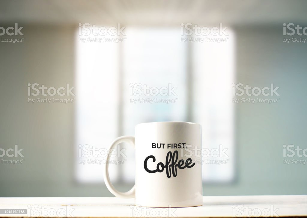 But first, Coffee text on mug in office view stock photo