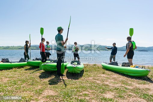 Group of sport enthusiasts getting ready for canoeing