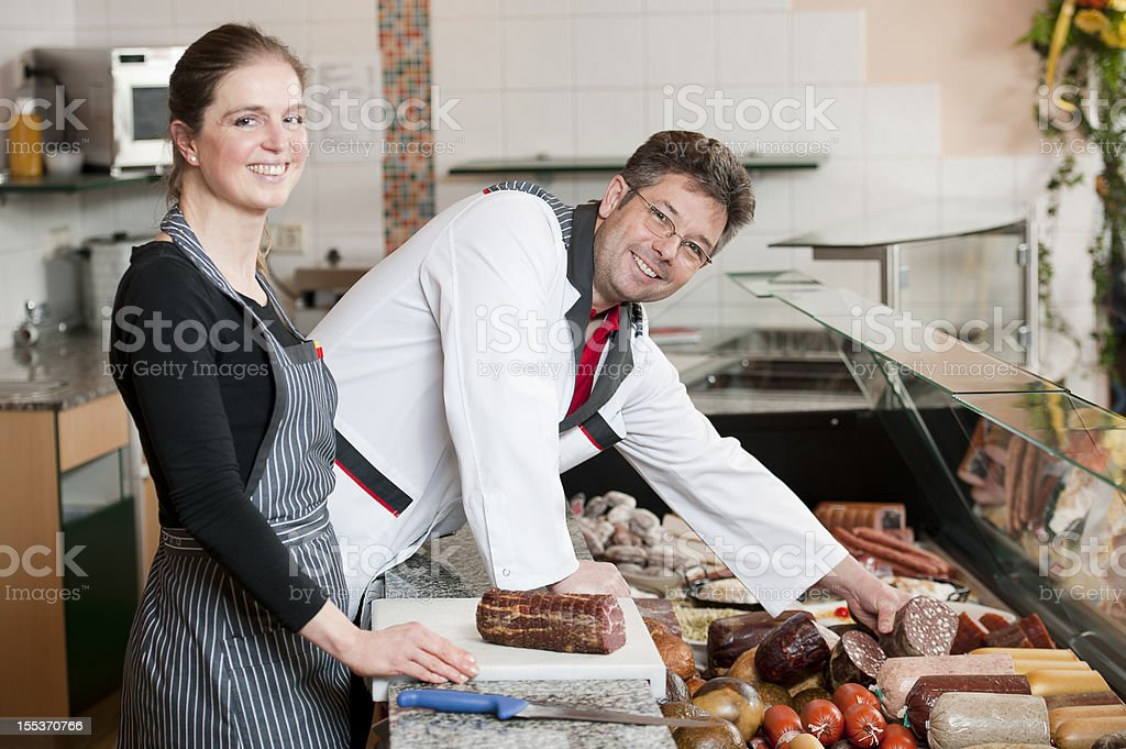 Butcher and sales executive stock photo