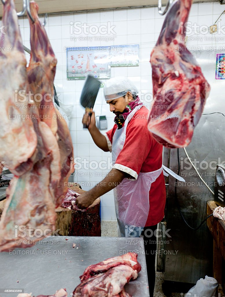 Butcher At Work On Meat Market In Dubai Stock Photo - Download Image