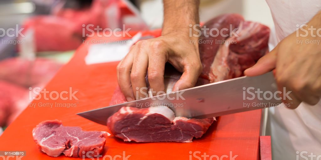 Butcher at work stock photo