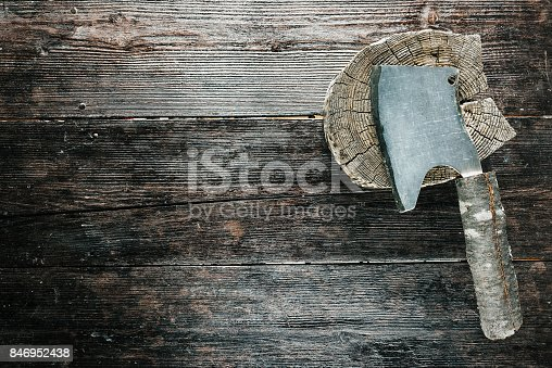 Butchers set for chopping meat: wooden block and chopper with rough handle