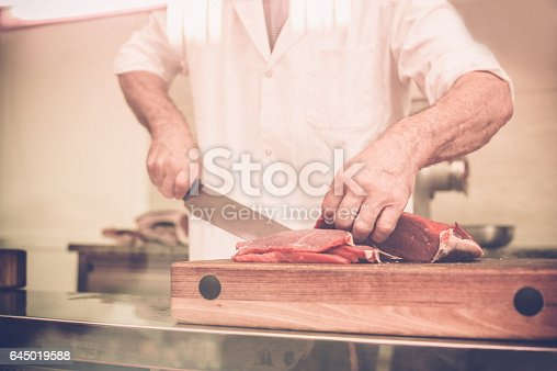 Butcher Cutting the Steaks