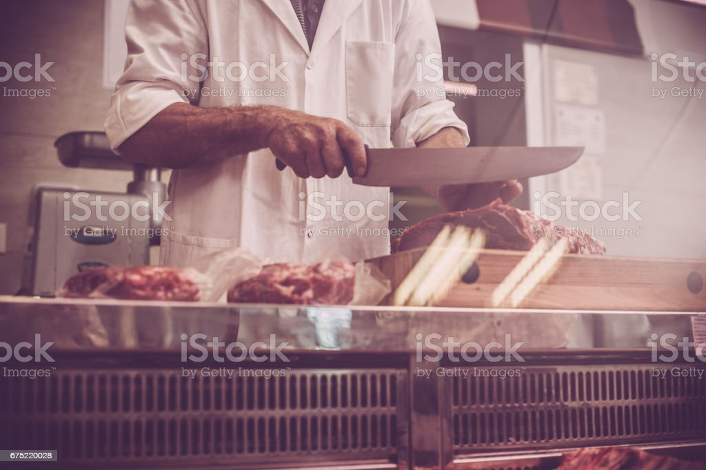 Butcher Cutting the Steaks royalty-free stock photo