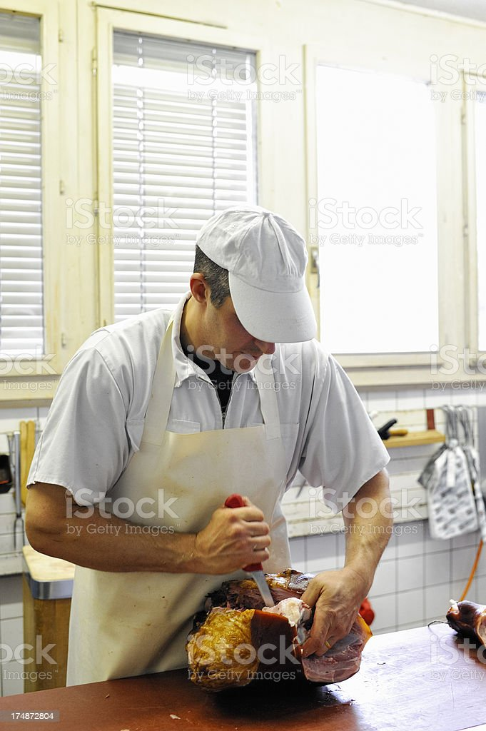 Butcher Deboning Boiled Ham stock photo