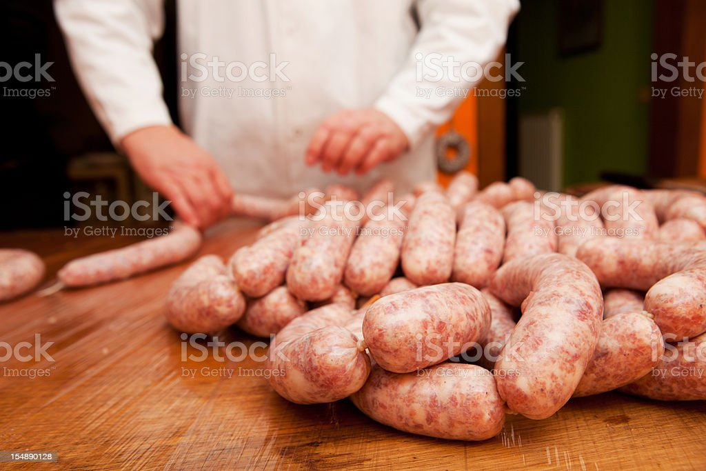 Butcher is making delicious Slovene pork sausages stock photo