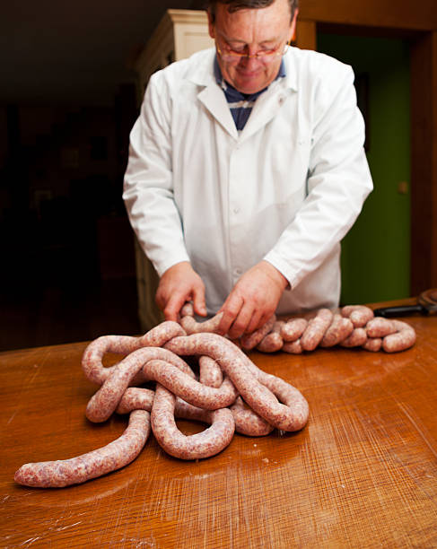 butcher is making delicious slovene pork sausages - human intestine stock photos and pictures