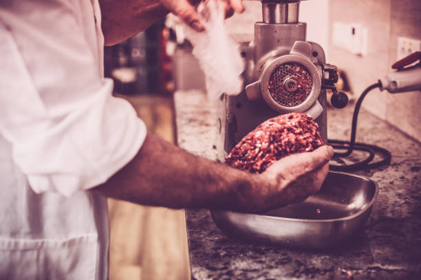 Butcher Preparing the Minced Meat stock photo