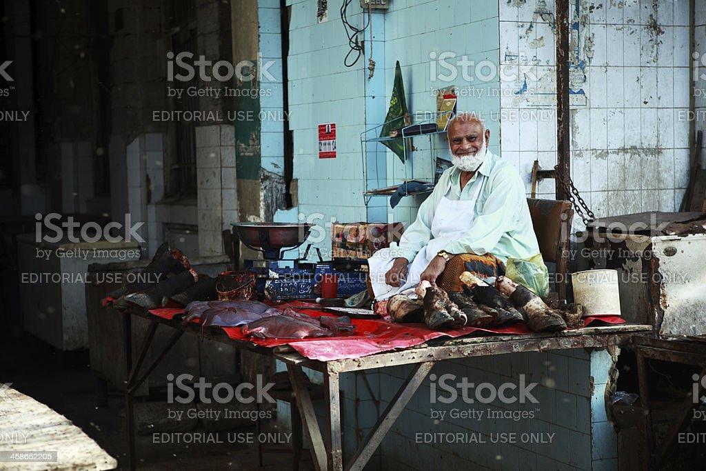 Butcher Selling Bulls Trotters in Asian Bazaar, Empress Market stock photo