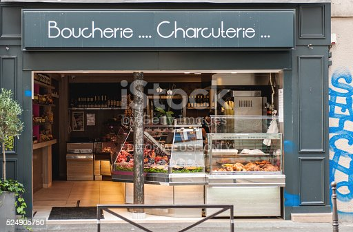 Paris, France - August 18, 2014: Boucherie and Charcuterie which means Butcher and Chartcuterie in the center of Paris, France