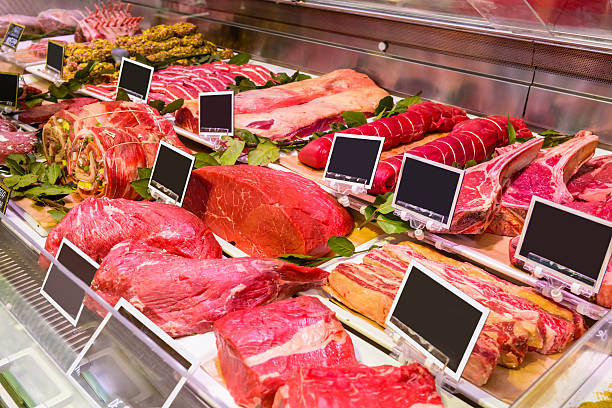 Butcher shop Photo of meats on a refrigeretor at a supermarket. Butcher shop. Butchery. red meat stock pictures, royalty-free photos & images