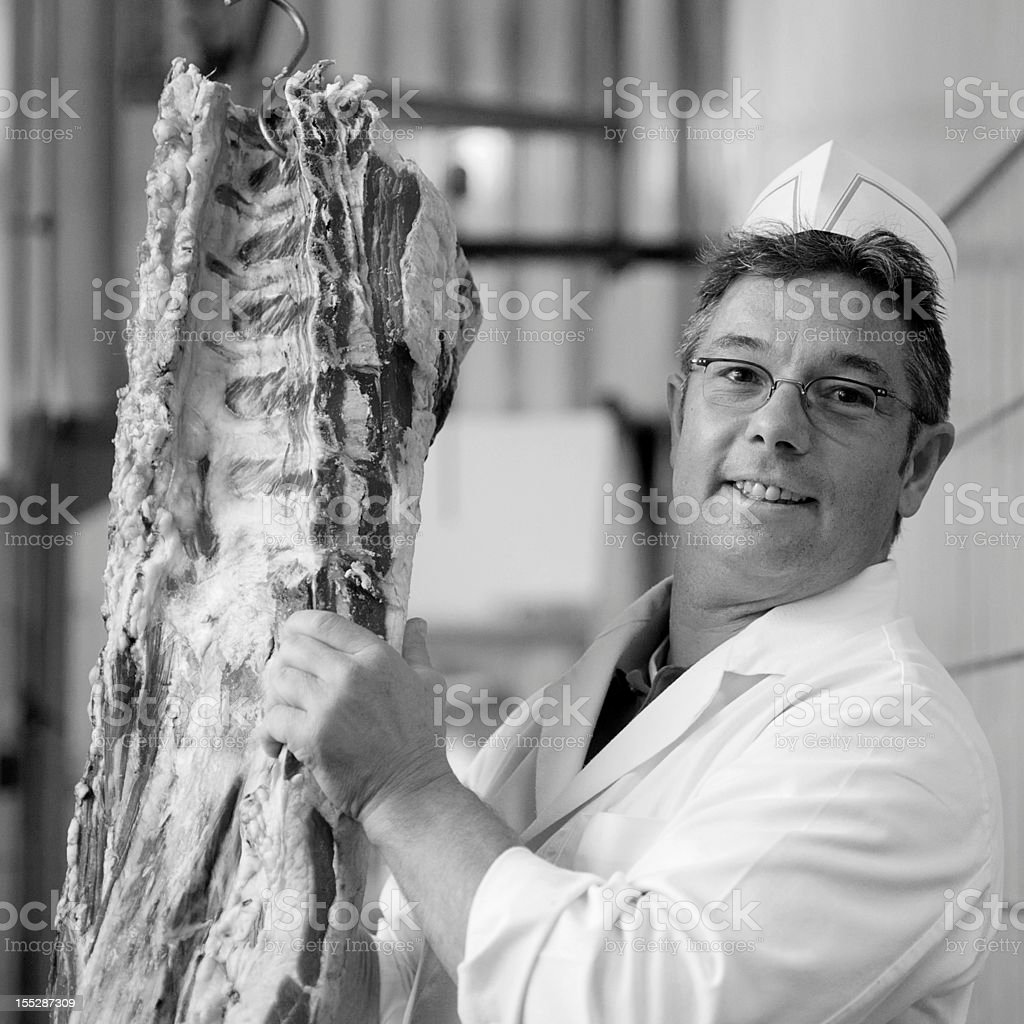 Butcher with meat royalty-free stock photo