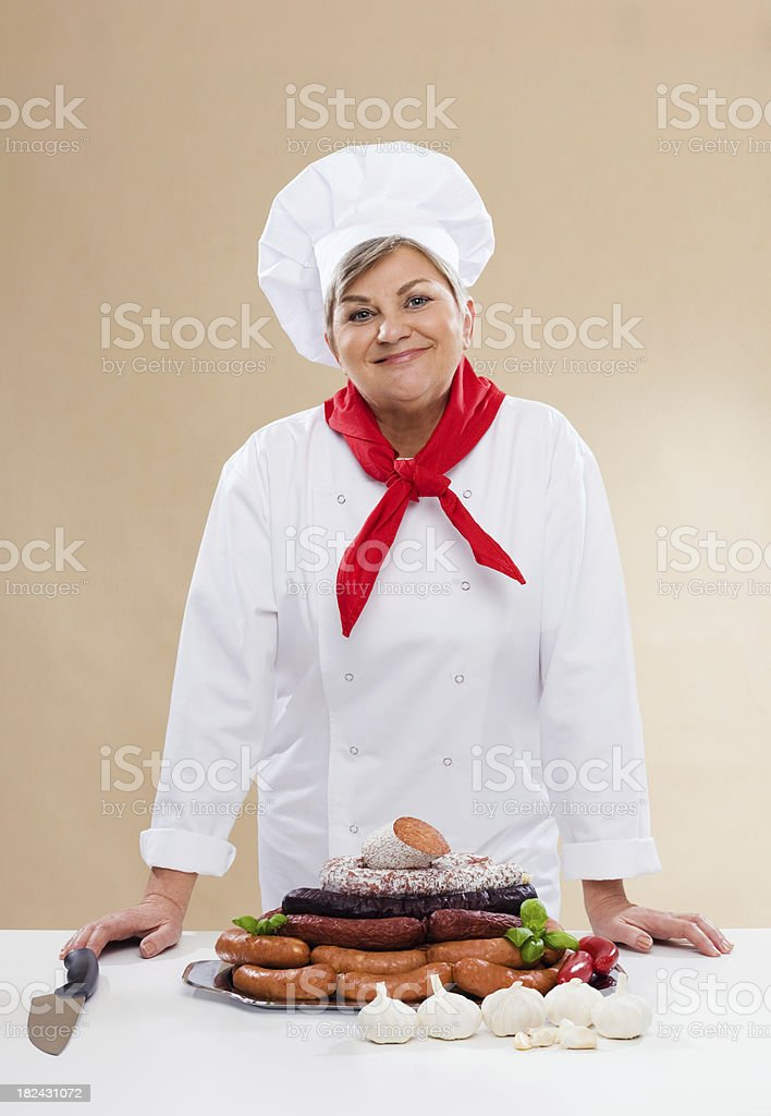 Butcher With Variety Of Sausages royalty-free stock photo