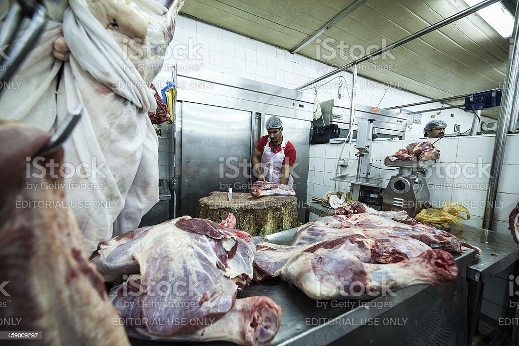Butchers at the Dubai meat market royalty-free stock photo