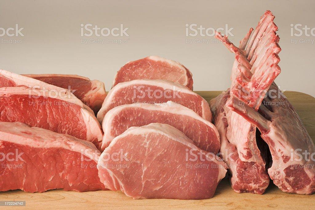 Butcher's Shop Meats—Raw Steak, Pork Chop, Rack of Lamb royalty-free stock photo