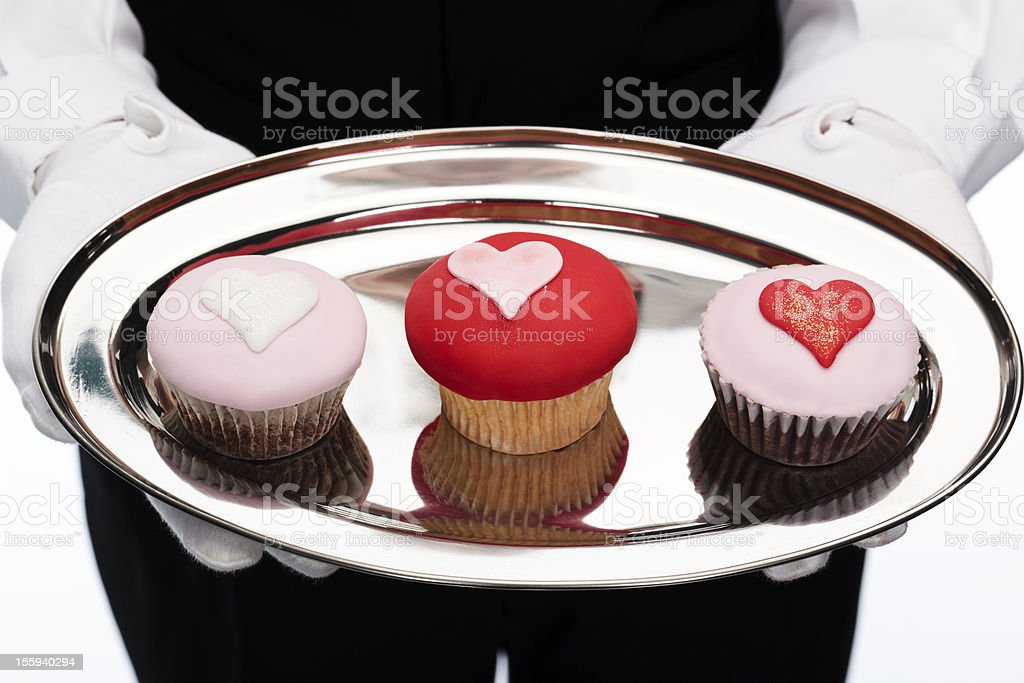 butler holding cupcakes royalty-free stock photo