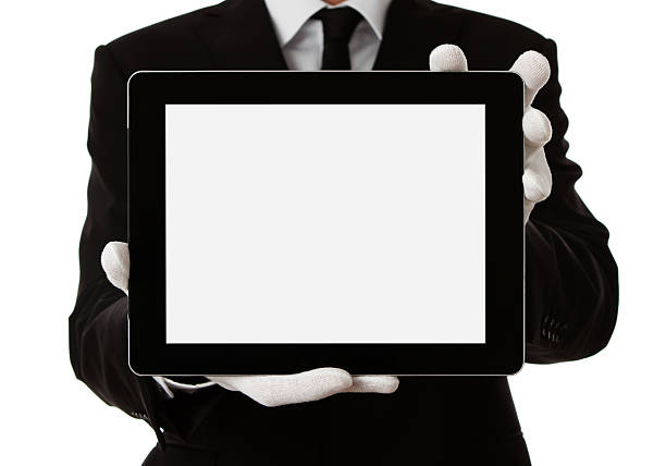 butler tenant la tablette numérique - paire de gants photos et images de collection